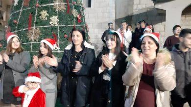 Photo of اضاءة شجرة الميلاد في ساحة كنيسة السيدة عرابة