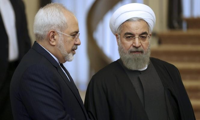 الرئيس الإيراني وظريف (أ ب)
